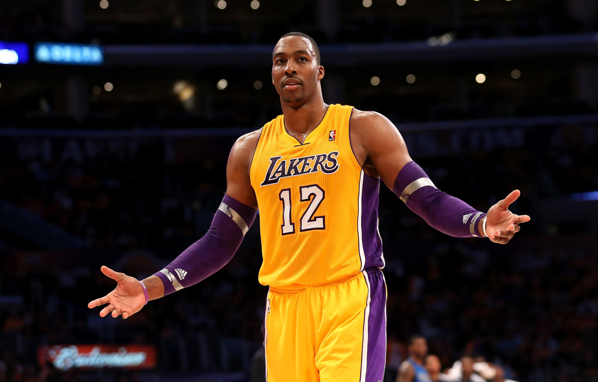 LOS ANGELES, CA - OCTOBER 30:  Dwight Howard #12 of the Los Angeles Lakers gestures to a referee after fouling out of the gam