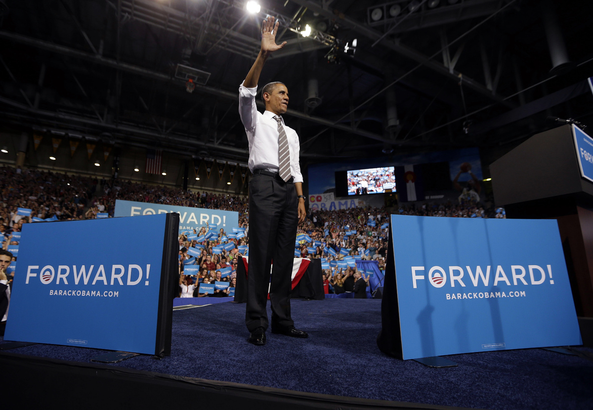 President Barack Obama waves to supporters after speaking at a campaign event at the University of Colorado - Boulder, Thursd