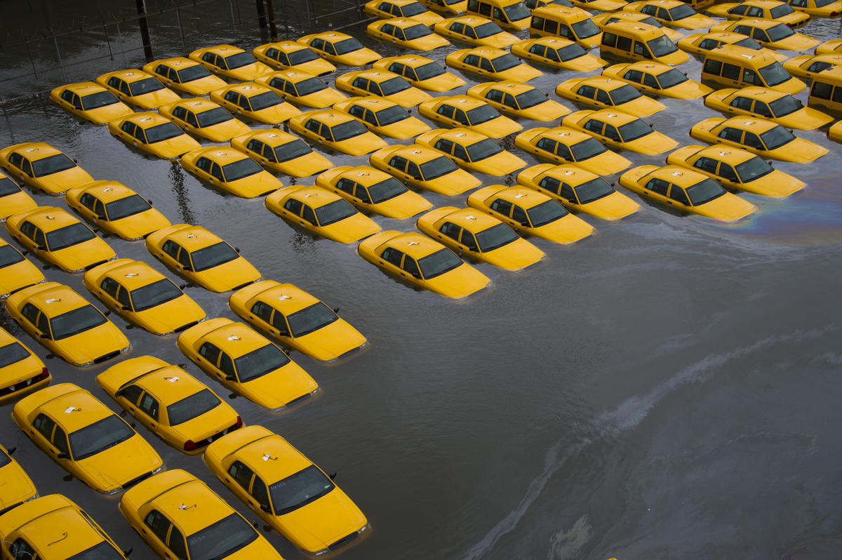 A parking lot full of yellow cabs is flooded as a result of superstorm Sandy on Tuesday, Oct. 30, 2012 in Hoboken, NJ. (AP Ph