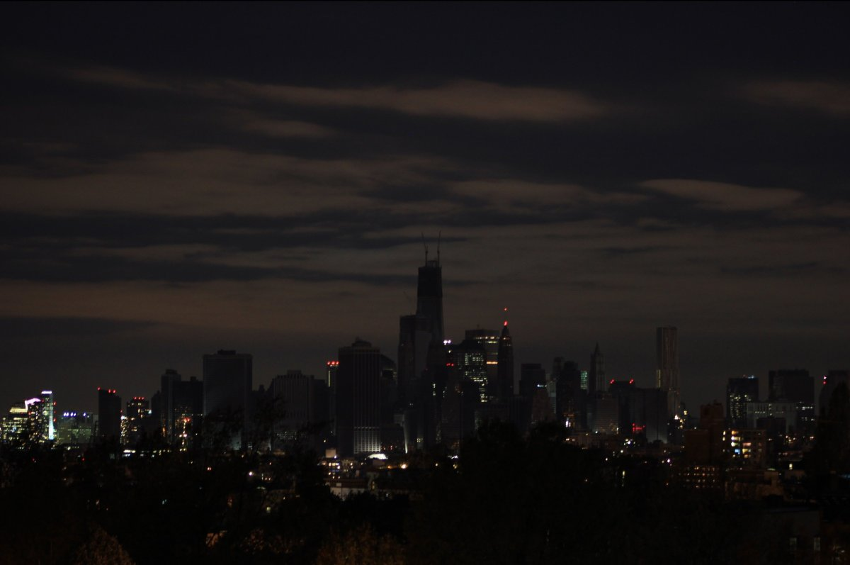 Only the buildings that have private, working generators are lit.  To the left are the skyscrapers of Jersey City.