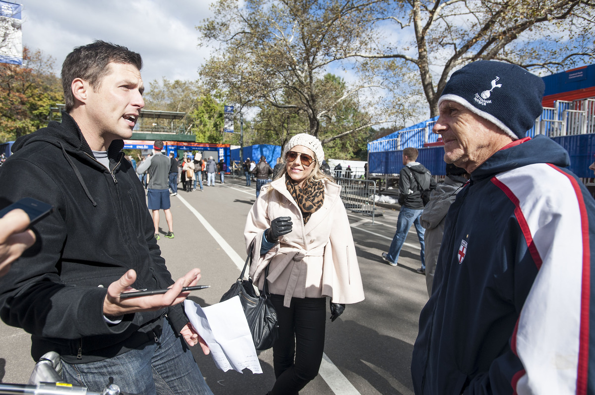 "Ben Hauck, left, talks to Jade Anson and Malcolm Anson in Central Park about the ""New York City Replacement Marathon"" that he"