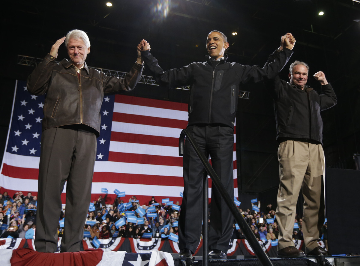 In the final hours of a four-state campaign day, President Barack Obama is joined by former President Bill Clinton, left, and
