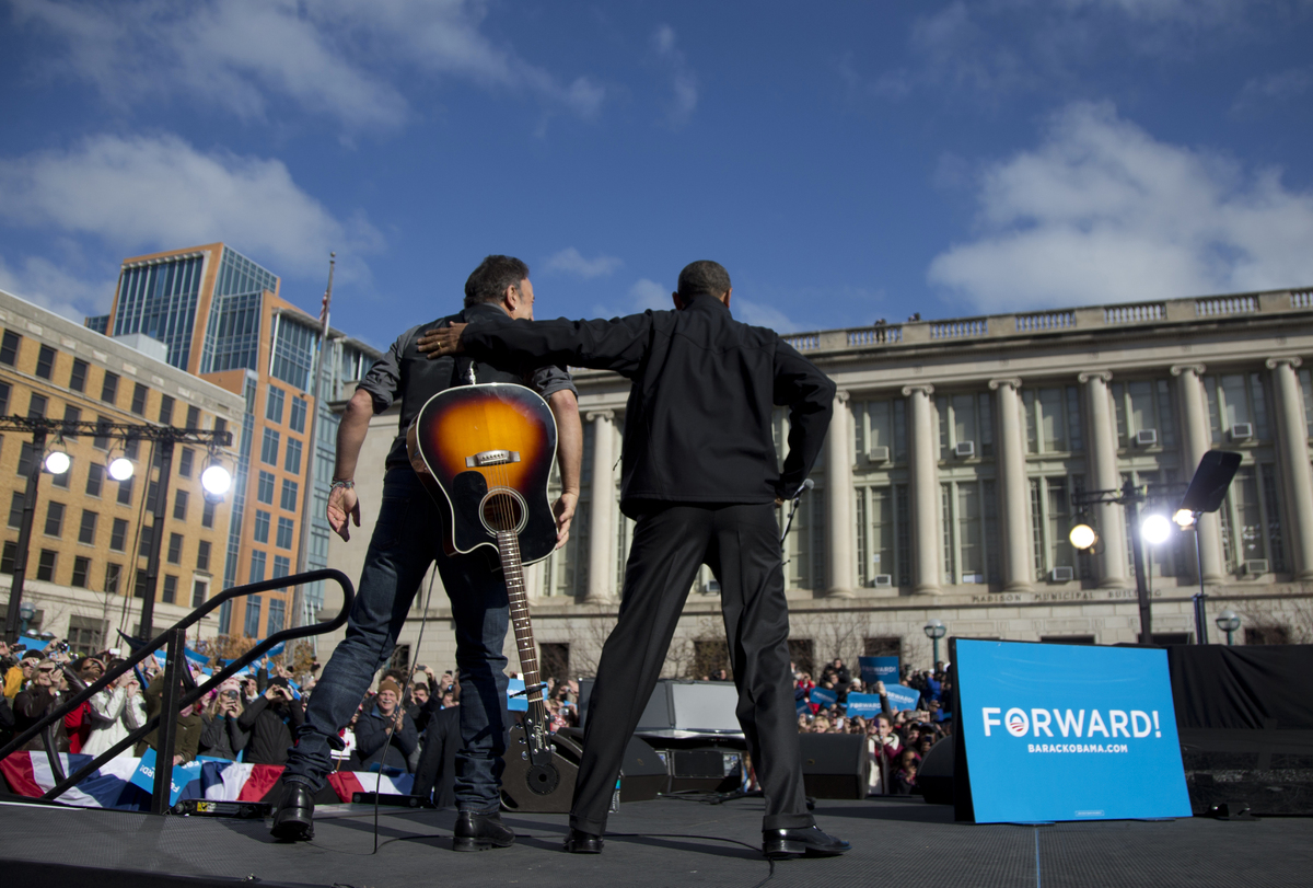 President Barack Obama stands with singer Bruce Springsteen as he arrives to speak at a campaign event, Monday, Nov. 5, 2012,
