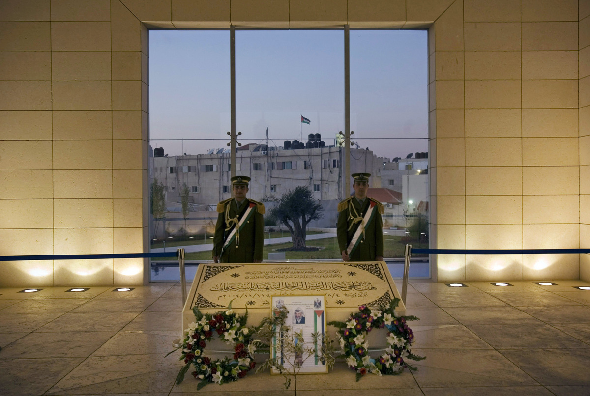 In this Nov. 10, 2008, file photo, members of the Palestinian Presidential Guard stand at the grave of the late leader Yasser