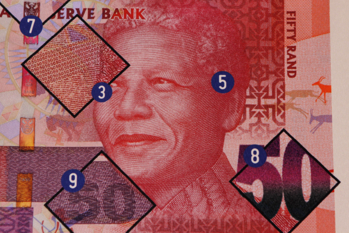 A poster showing safety features of a bank note bearing the image of former president Nelson Mandela, at a press launch, in P
