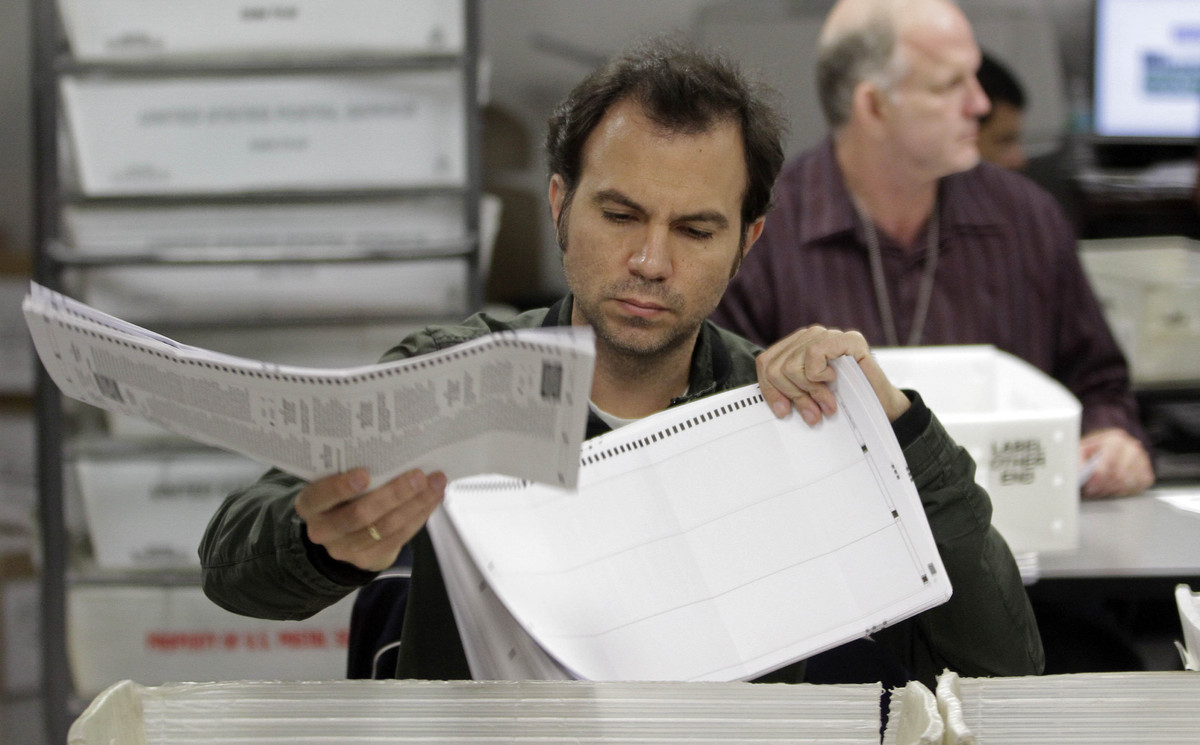 Miami-Dade Elections workers count absentee ballots in Doral, Fla., Wednesday, Nov. 7, 2012. Miami-Dade elections officials c