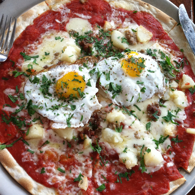 They call it the hangover pizza...potato, pancetta, sausage, and eggs sunny side up - it's everything you need to get your he