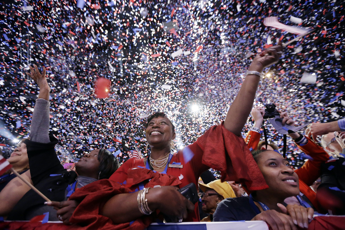 Supporters cheer at the end of President Barack Obama remarks during an election night party, early Wednesday, Nov. 7, 2012,