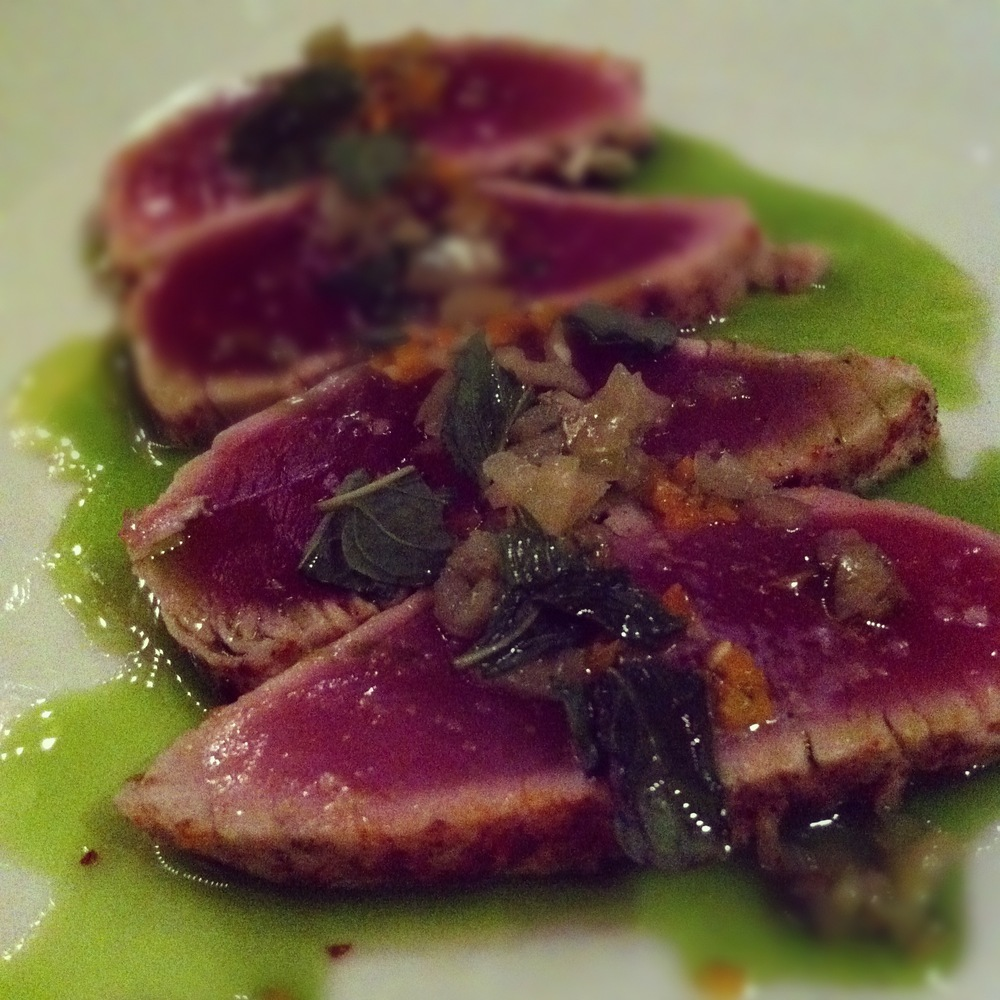 Herbsaint's butter poached Gulf tuna with pickled chilies and mint.