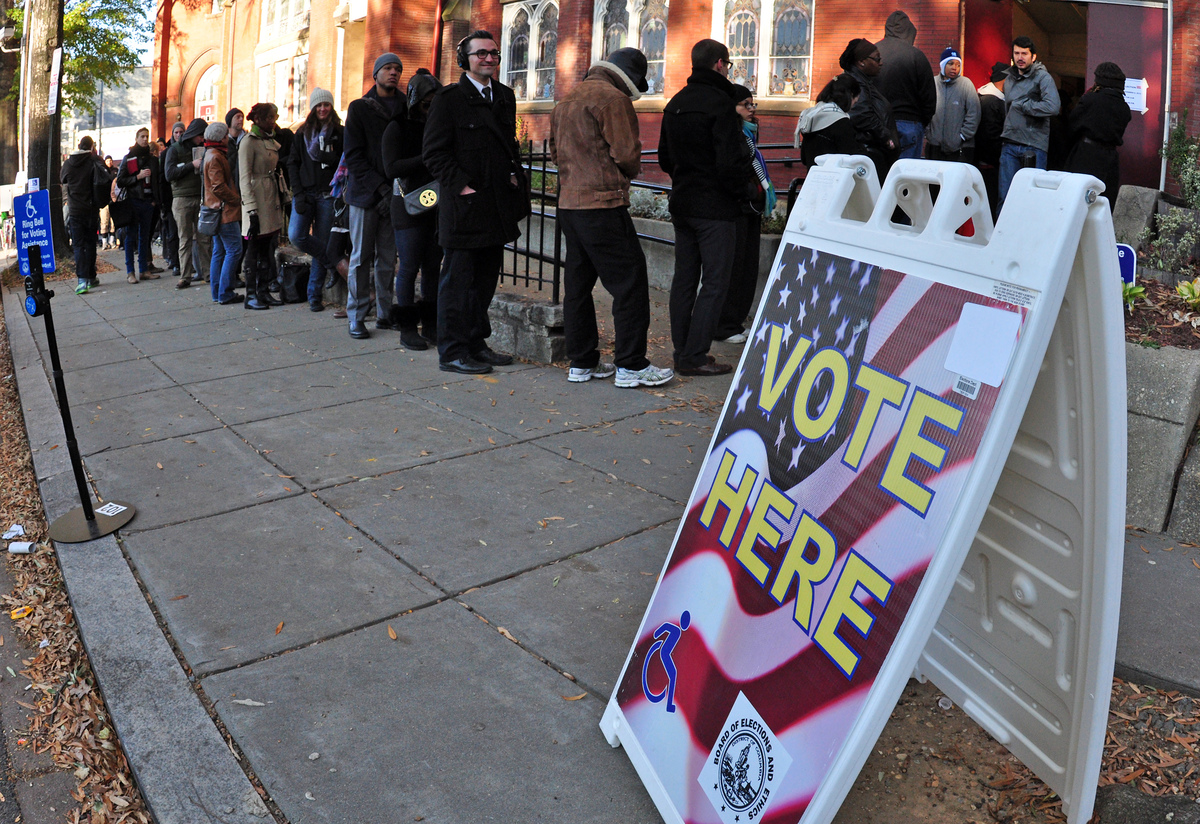 People wait outside Mt. Bethel Baptist Church in the Bloomingdale neighborhood of the District of Columbia to vote on Nov. 6,