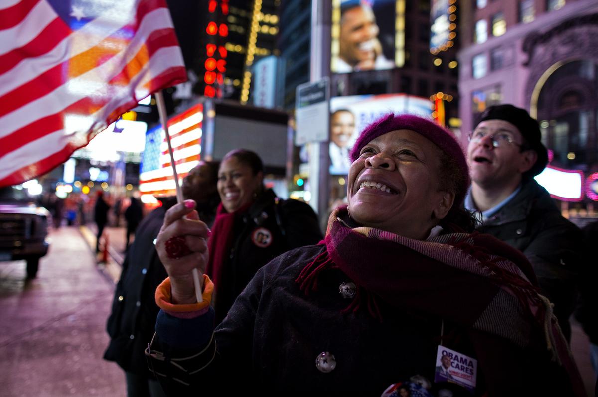 Ana Sledge of New York celebrates in New York's Times Square, Wednesday, Nov. 7, 2012, after President Barack Obama was proje