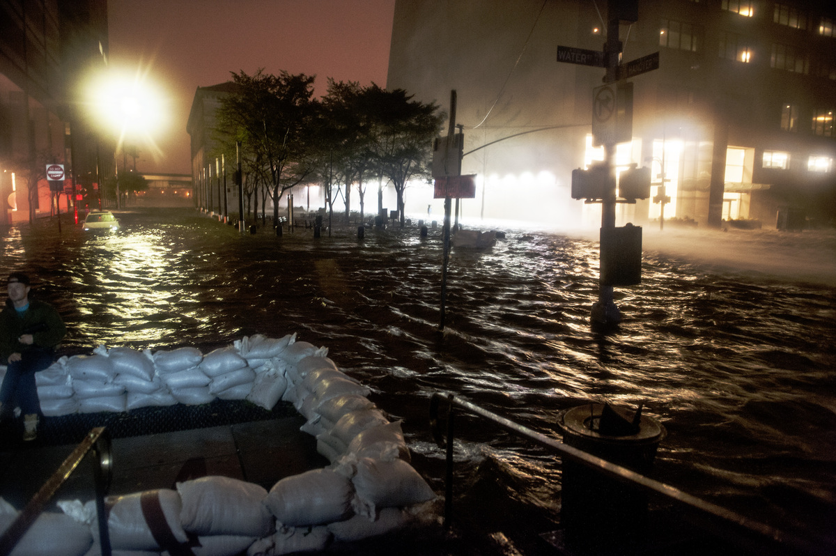 Hurricane Sandy batters the New York City skyline as the Lower Manhattan streets are inundated with flood waters from Sandy's