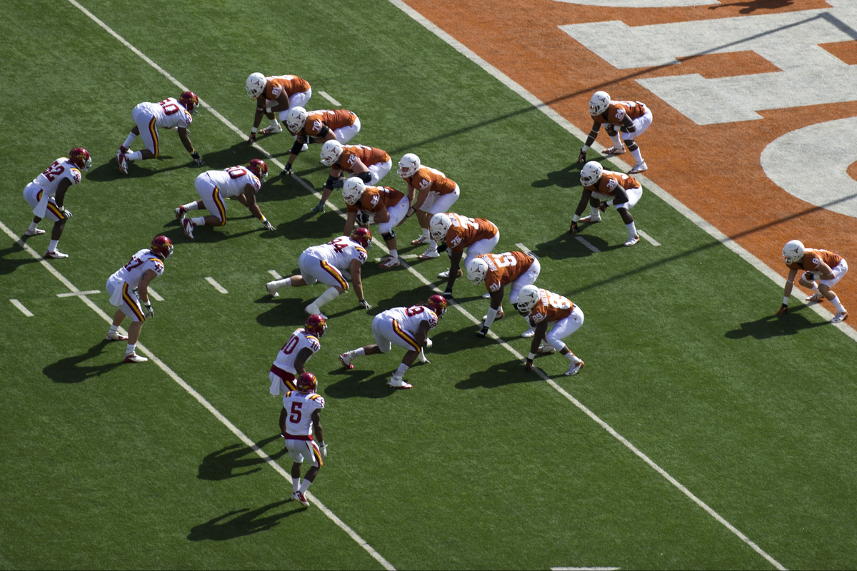 AUSTIN, TX - NOVEMBER 10:  The Texas Longhorns line up in the wishbone formation for the first play in honor of Darrell K Roy