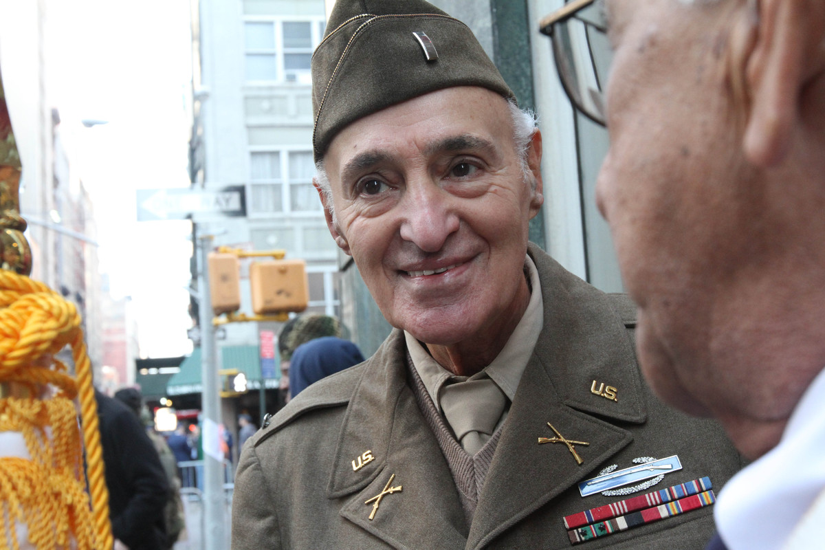 WWII veteran Eugene Cannava, 86, from New York, left, chats with Korean War veteran Samuel Benchimol, 81, from Glen Head, N.Y