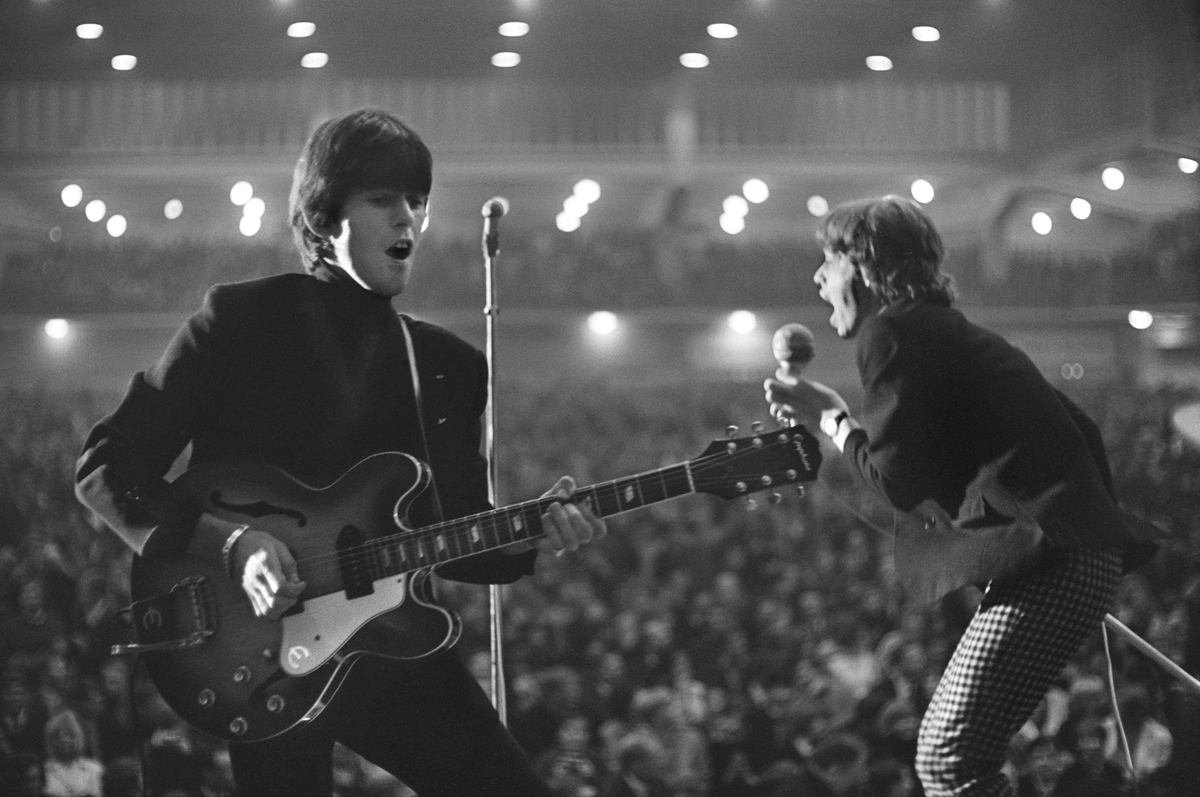Keith Richards and Mick Jagger shot from behind the stage in Hamburg, West Germany on September 13, 1965