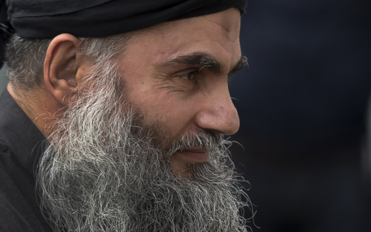 Abu Qatada arrives back at his residence in London after being freed from prison, Tuesday, Nov. 13, 2012. (AP Photo/Matt Dunh