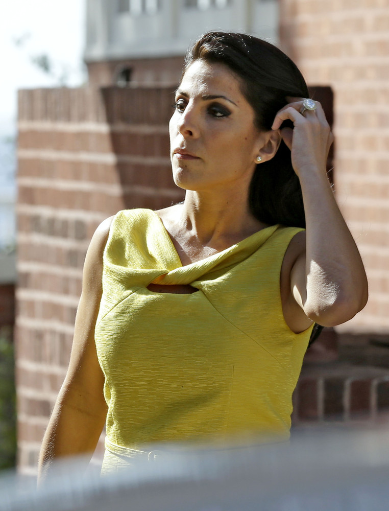 Jill Kelley leaves her home Monday, Nov 12, 2012 in Tampa, Fla. Kelley is identified as the woman who allegedly received hara