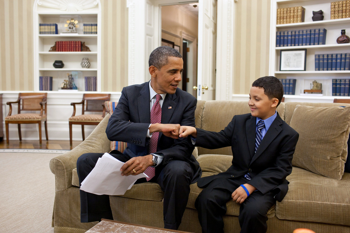 President Barack Obama fist-bumps Make-a-Wish child Diego Diaz after reading a letter he wrote.