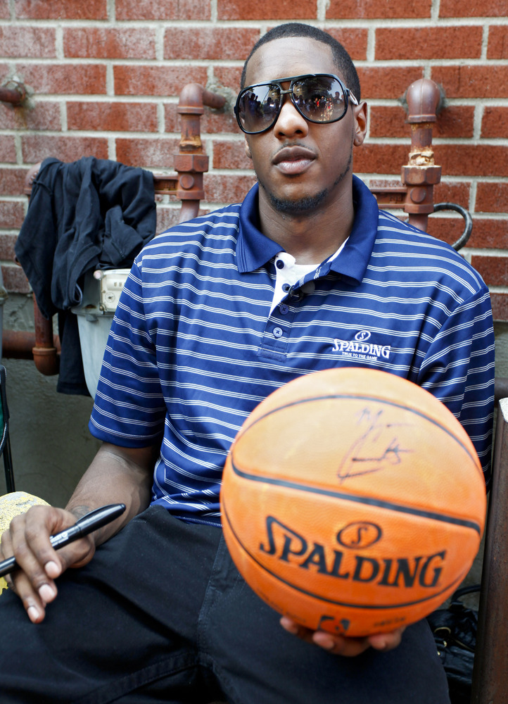 "Miami Heat Guard Mario Chalmers plays 18-year-old Carlos Mayorga, the winner of Spalding Basketball's ""Arena to Driveway"" com"