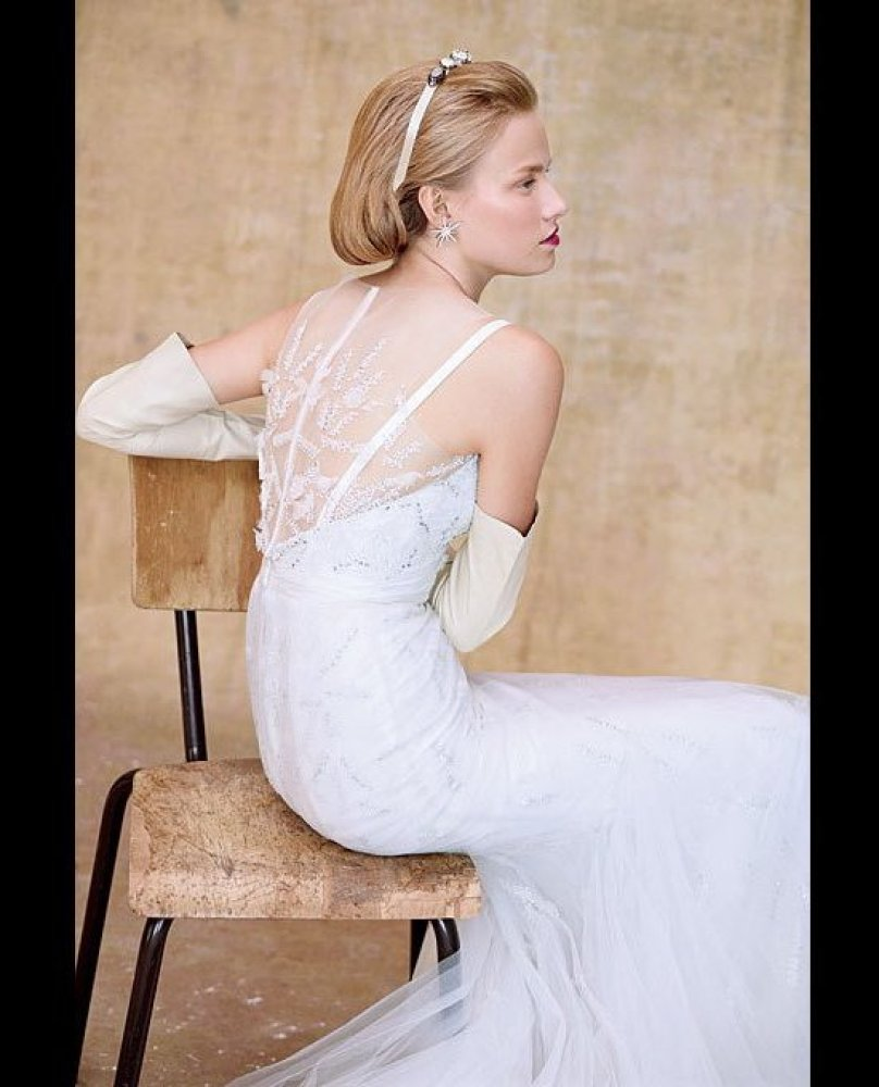 """Fit-and-flare gown embroidered with pearls, sequins, and flowers, $6,950, Reem Acra. <em><a href=""""http://www.brides.com/weddi"""
