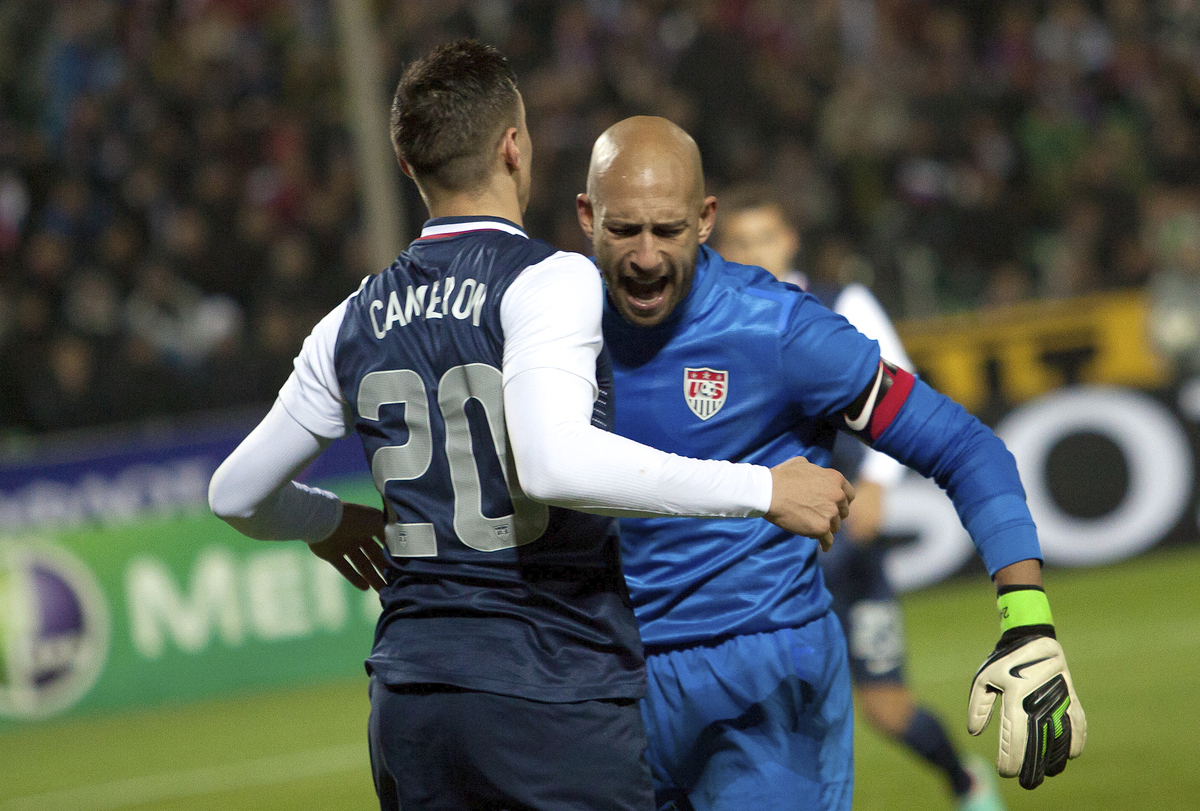 Geoff Cameron, left, and goalkeeper Tim Howard, both of the United States, react after a successful defense attempt during th
