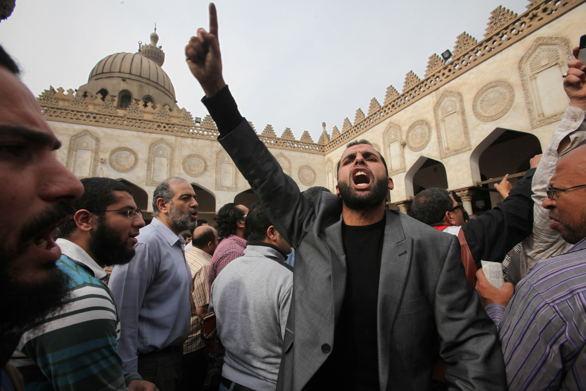 Protesters chant slogans against the Israeli invasion of Gaza, in Al-Azhar mosque, where President Mohammed Morsi's Muslim Br