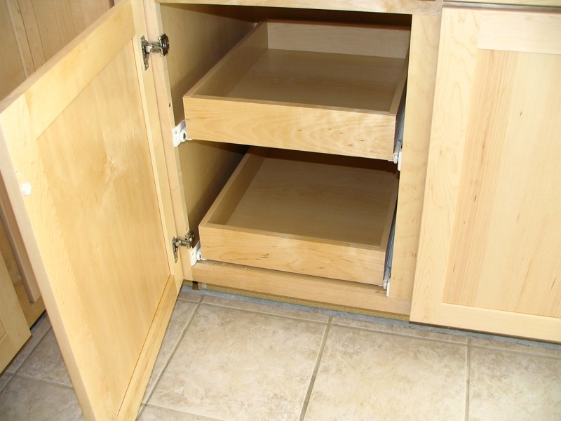 Add more storage space to your kitchen by installing roll-out shelving. After measuring your cabinet, use a saw to cut the si
