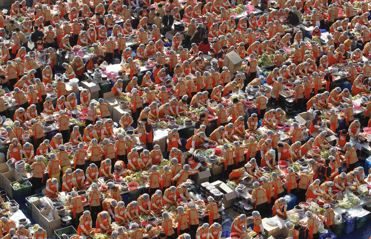 SEOUL, SOUTH KOREA - NOVEMBER 15:  More than two thousand housewives make Kimchi for donation to the poor in preparation for