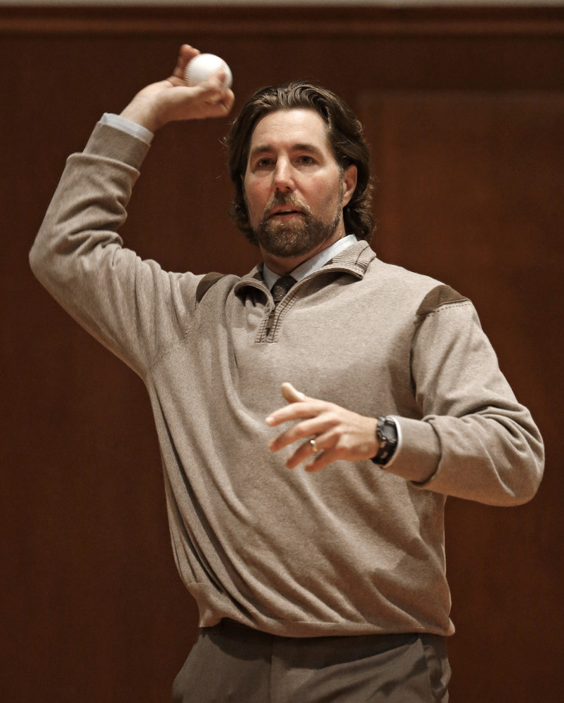Baseball's National League Cy Young Award winner R. A. Dickey, of the New York Mets, demonstrates a knuckleball for students