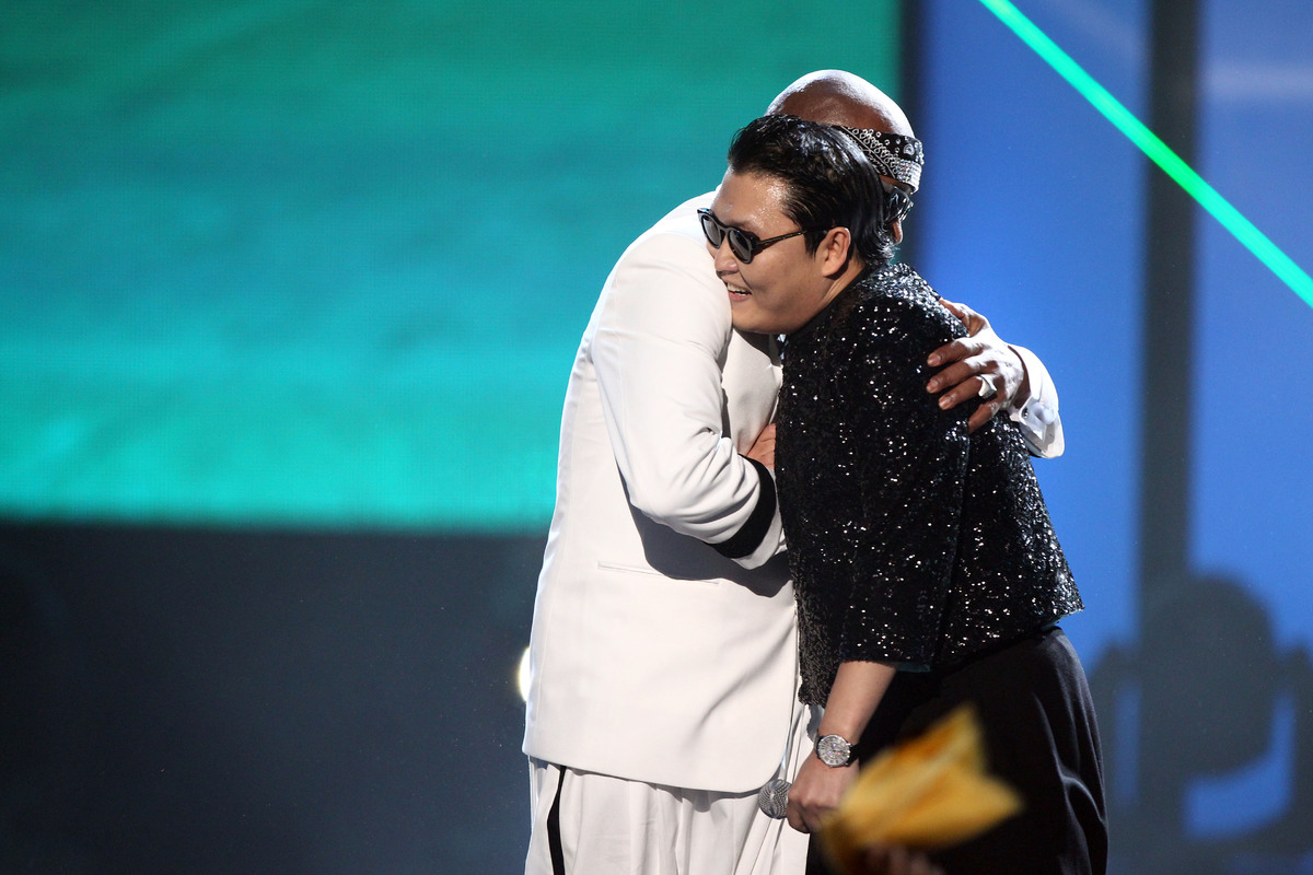 MC Hammer, left, and PSY are seen on stage at the 40th Anniversary American Music Awards on Sunday, Nov. 18, 2012, in Los Ang