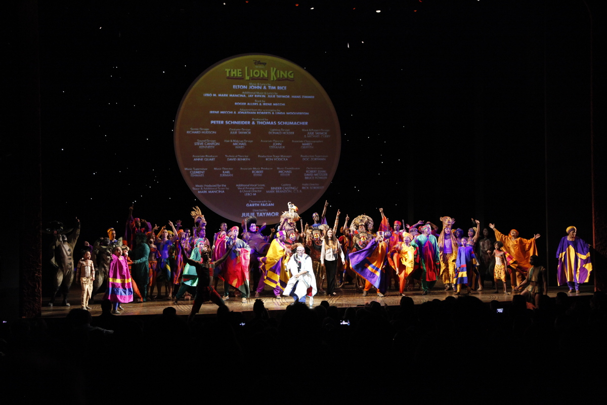 Julie Taymor and Lebo M lead the cast in a performance of One By One