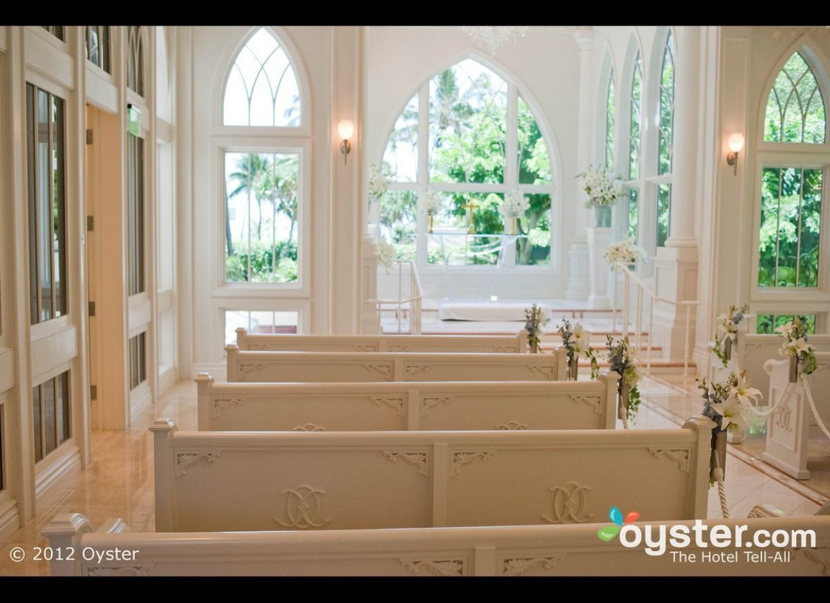 The Ocean Crystal Wedding Chapel at Oahu's Hilton Hawaiian Village is a gorgeous spot to exchange vows. Decked out all in whi