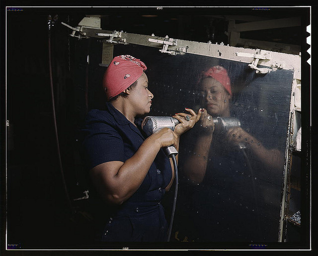 "Operating a hand drill at Vultee-Nashville, woman is working on a ""Vengeance"" dive bomber, Tennessee (LOC)  Photographer: Pal"