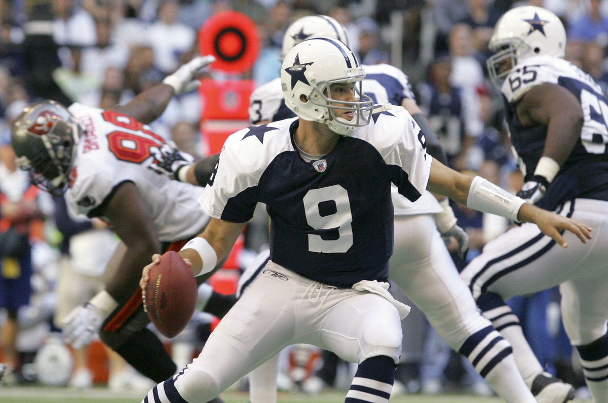 """In just his fifth NFL start, Tony Romo stirred up the Dallas faithful by throwing for five touchdowns <a href=""""http://scores."""