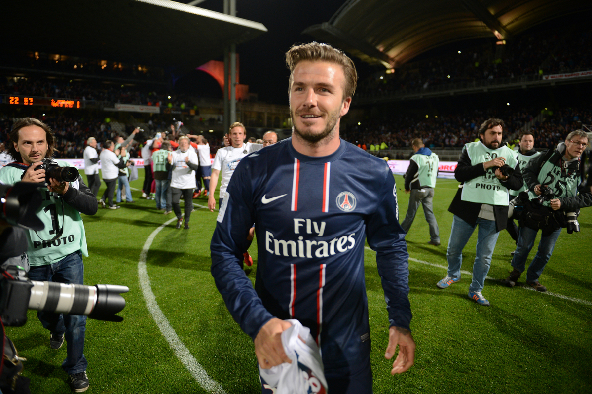 Paris' British midfielder David Beckham celebrates after  Paris Saint-Germain won the French L1 title on May 12, 2013 at the