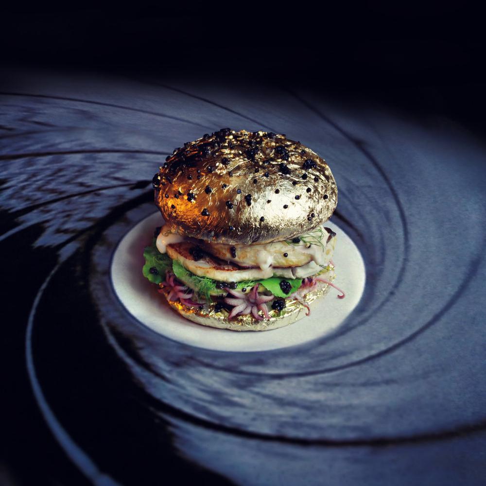 Caviar, unpeeled garlic, quail eggs, octopus, miso and a golden bun.