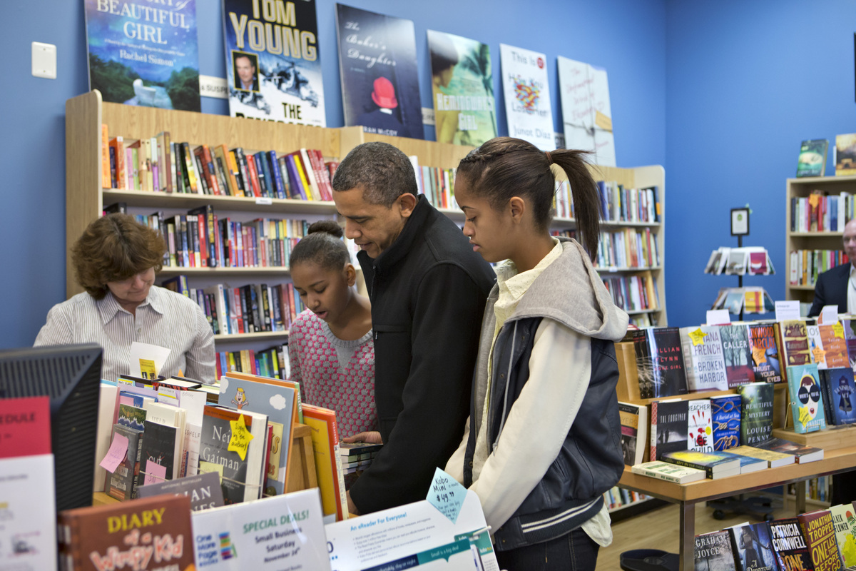 President Barack Obama, with daughters Sasha, left, and Malia, bought fifteen children's books for family and friends today a