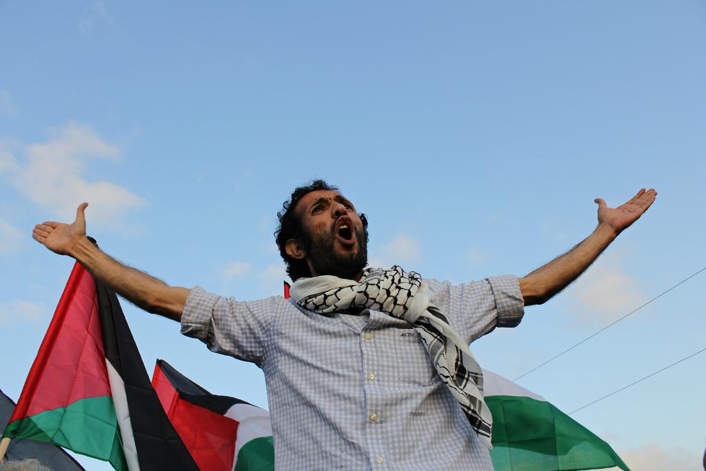 "Member of an Egyptian convoy at the Rafah border crossing, Egypt. <a href=""http://www.flickr.com/photos/gigiibrahim/"">(Gigi I"