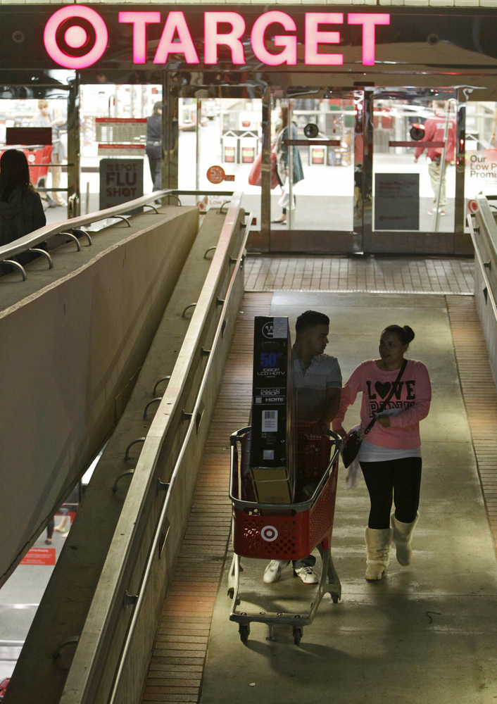 Consumers shop early morning hours Friday, Nov. 23, 2012 at the Target store in the Glendale Galleria mall in Glendale, Calif