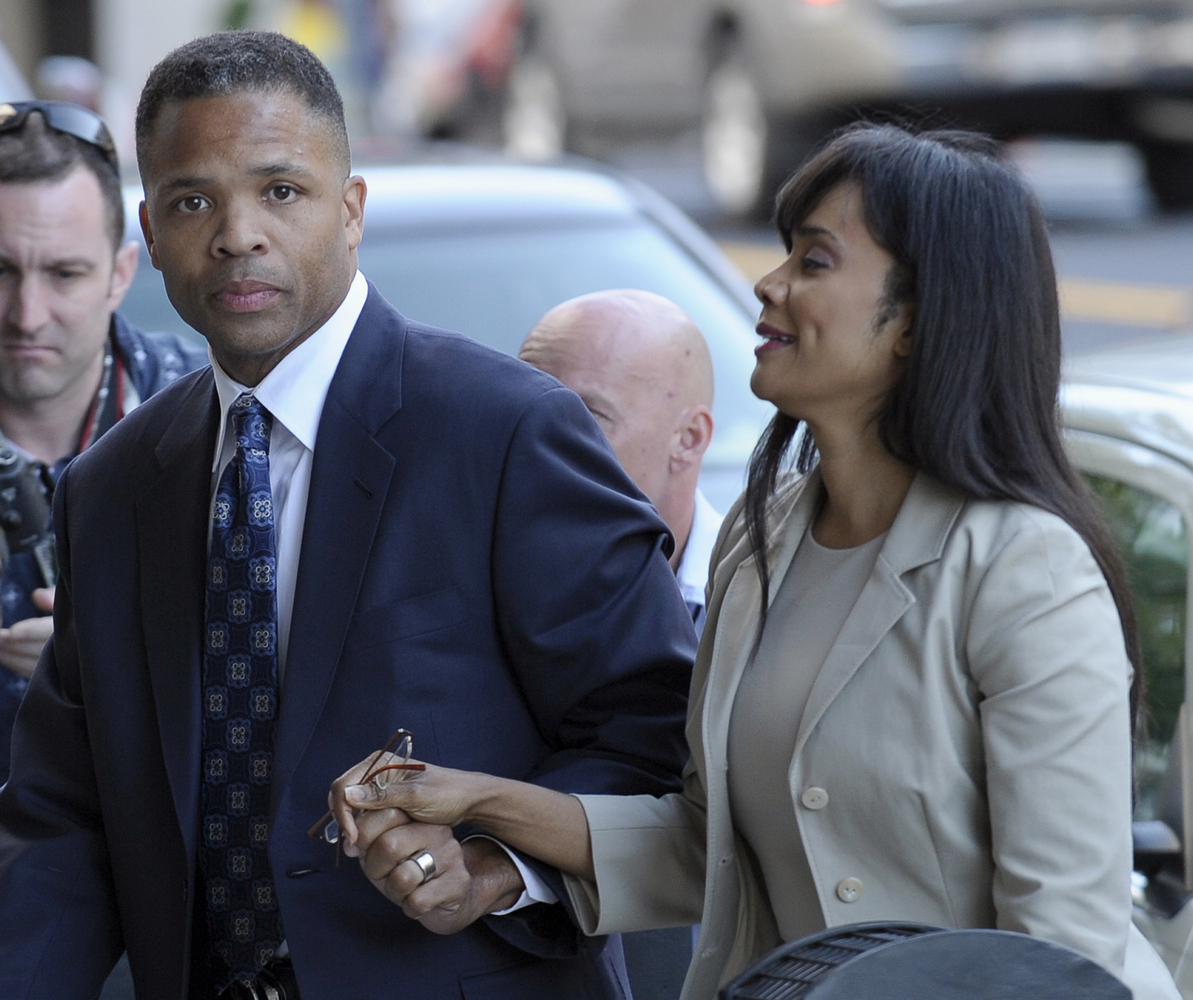 Former Illinois Rep. Jesse Jackson Jr. and his wife, Sandi, arrive at federal court in Washington, Wednesday, Aug. 14, 2013,