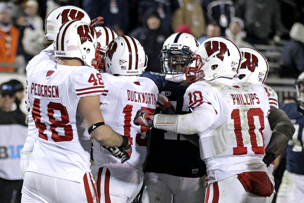 Wisconsin wide receiver Jeff Duckworth (15) celebrates with teammates as Penn State linebacker Gerald Hodges, third from righ