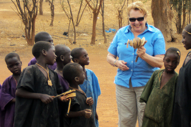 Anais Troadec takes time out to visit with local children during her third volunteer assignment to Mali, where she conducted