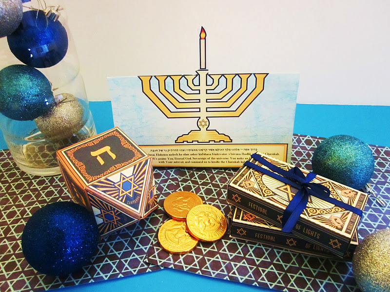 Here you'll find some staples for your holiday decor: a paper dreidel, a small box perfect for storing gelt and even a menora