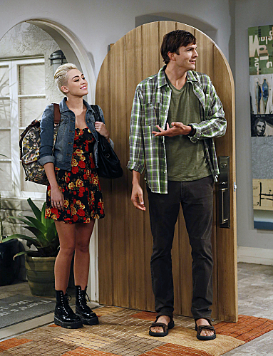 Walden (Ashton Kutcher, right) starts to feel his age when Missi (special guest star Miley Cyrus, left), the daughter of a fr