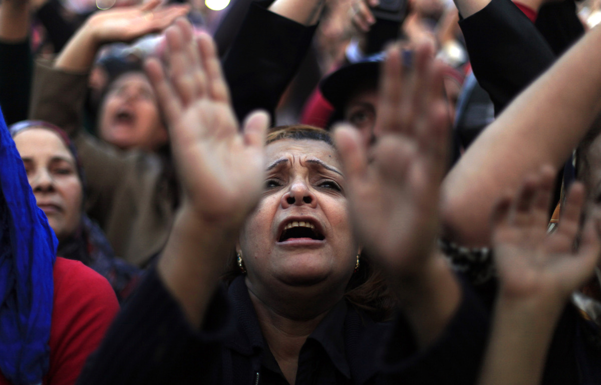 Egyptian protesters chant slogans at rally in Tahrir Square in Cairo, Egypt, Tuesday, Nov. 27, 2012. Egyptians flocked to Cai
