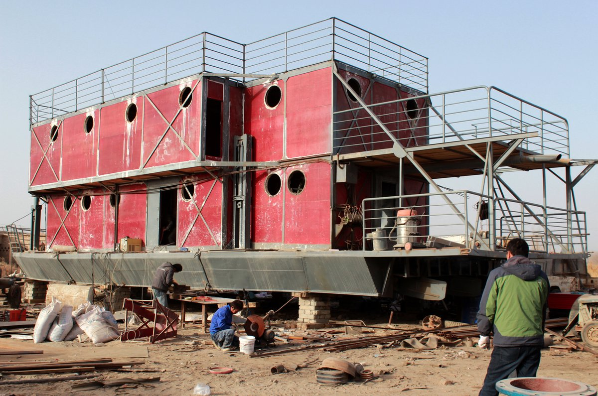 This photo taken on November 24, 2012 shows the unfinished boat built by Lu Zhenhai, a man from Urumqi, Xinjiang Uyghur Auton
