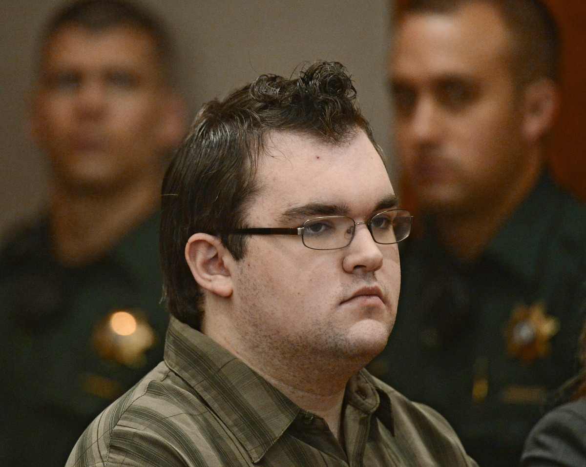 Austin Sigg is sits in court in Golden, Colo., where he was sentenced to life plus 86 years on Tuesday, Nov.19, 2013. Sigg, 1