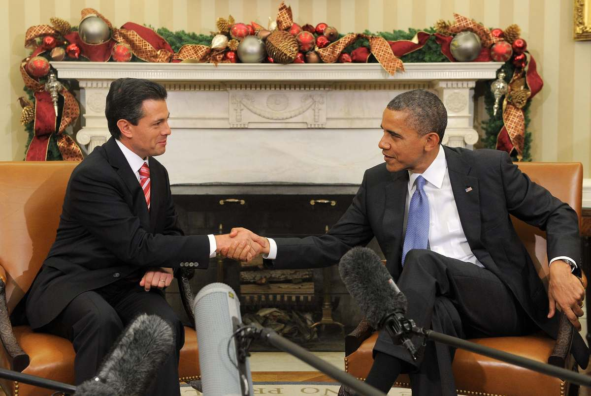 US President Barack Obama shakes hands with President-elect Enrique Pena Nieto of Mexico during a bilateral meeting in the Ov