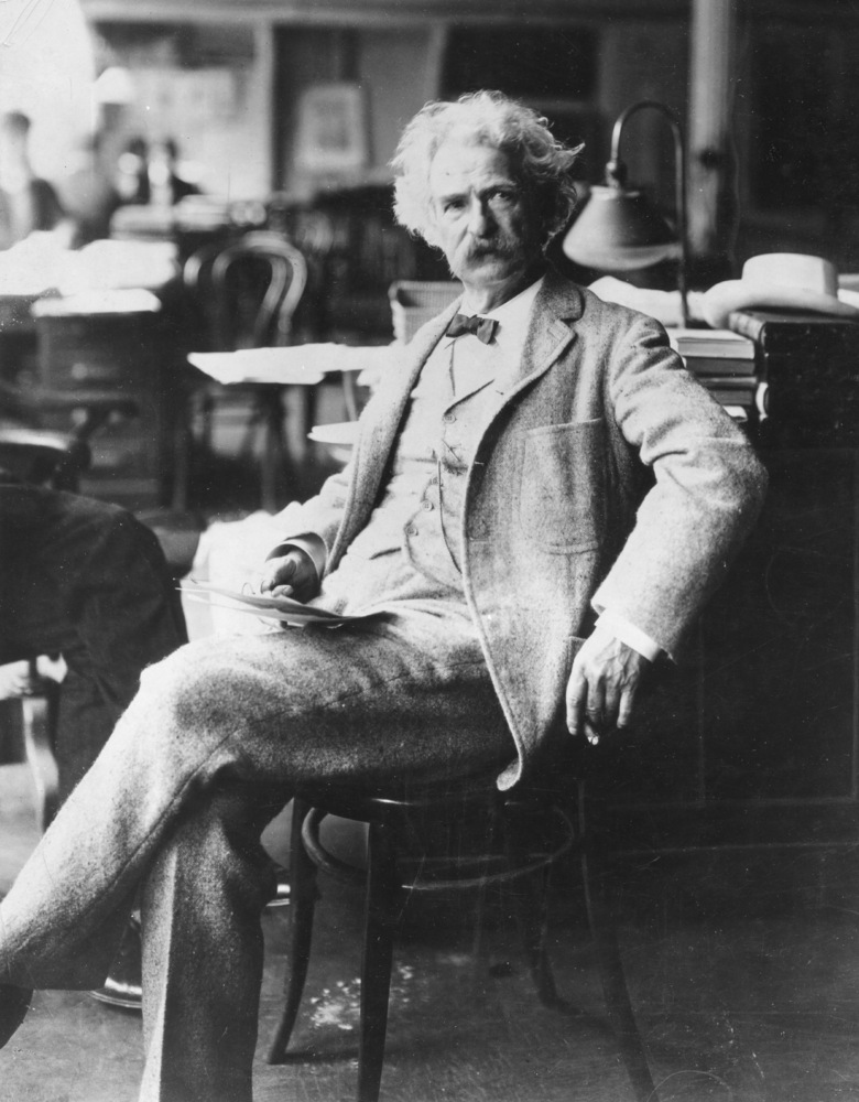 Portrait of American author Samuel Clemens (1835 - 1910), better known as Mark Twain, as he sits in a chair, late 19th centur