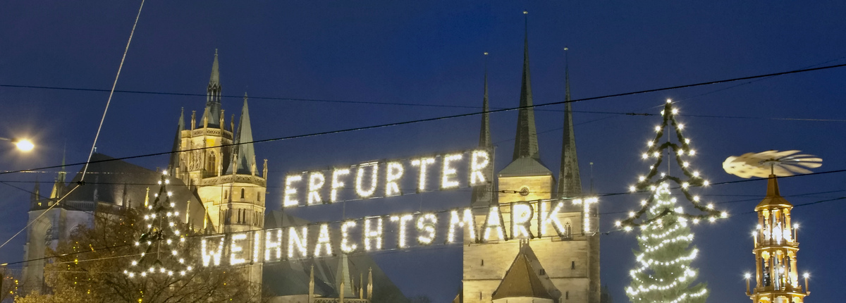 Lights illuminate the Christmas Fair in front of the Mariendom (Cathedral of Mary), left, and St. Severi's Church in Erfurt,
